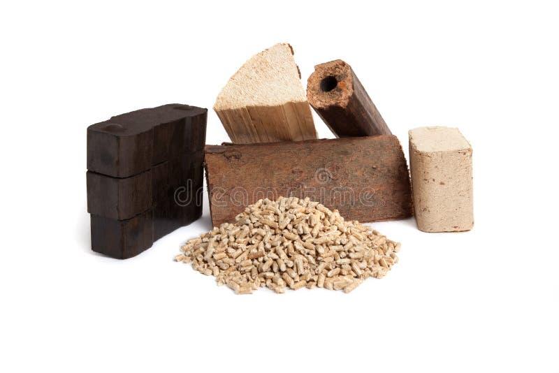 Fossiele brandstoffen, houten korrels, brandhout, briketten, koolstof stock afbeelding