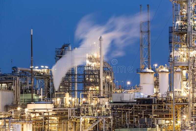 Fossil Fuel Industry - Chemical Plant or Refinery by Dusk royalty free stock photos
