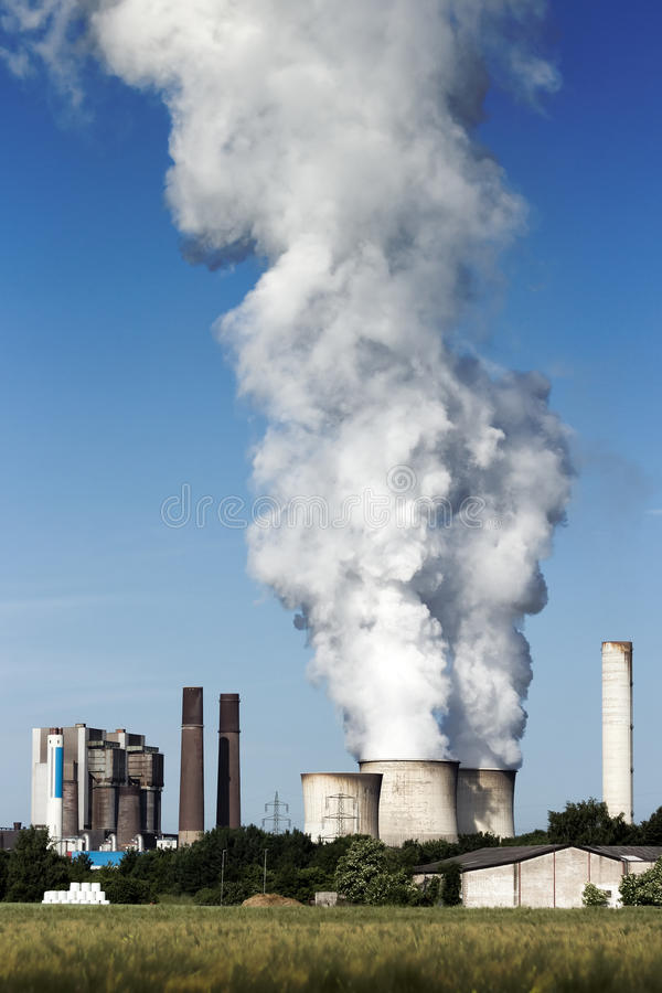 Fossil fuel power. Brown coal fuel power station emission royalty free stock images