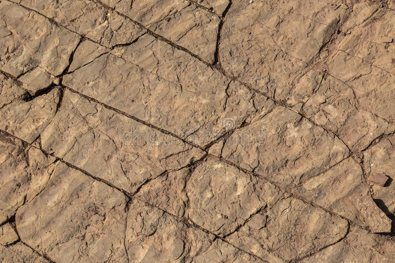 Fossilized Ripples in Fractured Sandstone Useful as Background o. Fossilized mud or sand ripples from the bottom of an ancient lake in fractured sandstone useful royalty free stock photos