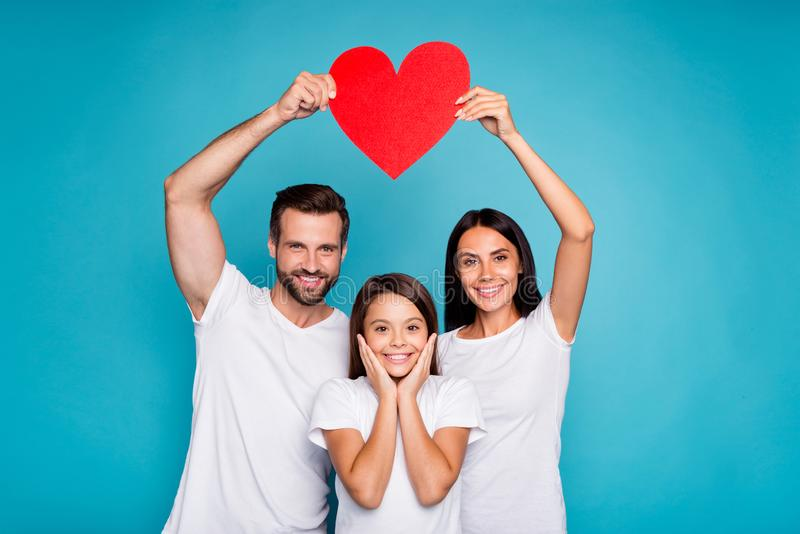 Foster family taking care of little daughter show heart figure wear casual outfit isolated blue background royalty free stock photo
