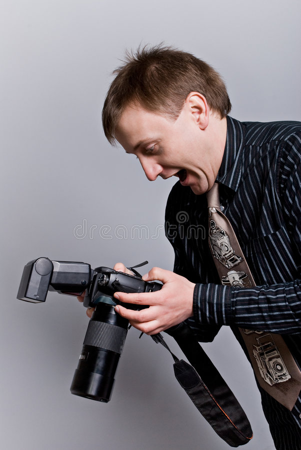 Fotógrafo com câmera fotos de stock royalty free