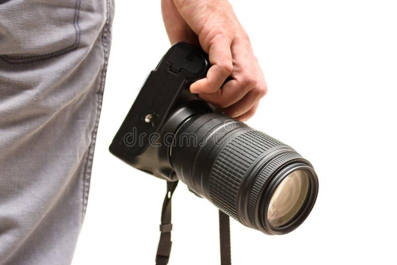 Fotógrafo com uma câmera de reflexo e uma lente teleobjetiva fotos de stock