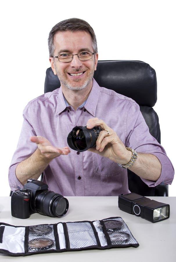 Fotógrafo con el equipo fotografía de archivo