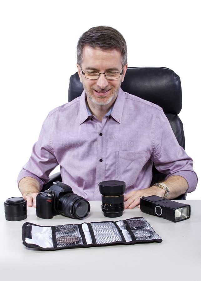 Fotógrafo con el equipo fotografía de archivo libre de regalías