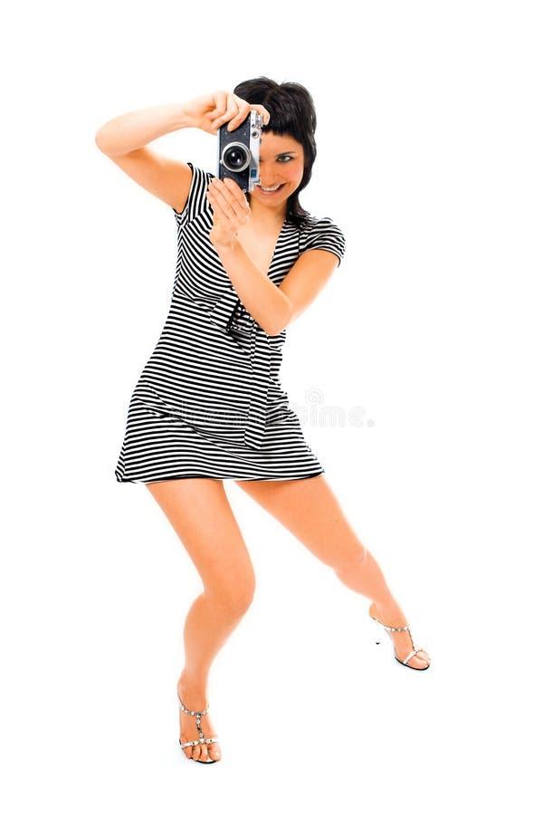 Fotógrafo da menina da beleza na veste do marinheiro com câmera da foto foto de stock