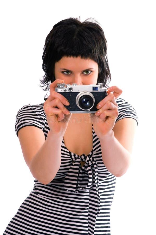 Fotógrafo de la muchacha de la belleza en el chaleco del marinero con la cámara de la foto fotos de archivo