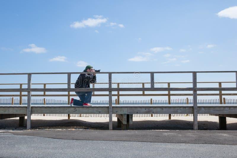 Fotógrafo de la playa fotografía de archivo