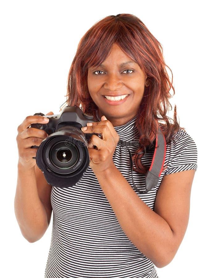 Fotógrafo de sexo femenino del afroamericano que le tira imagen de archivo