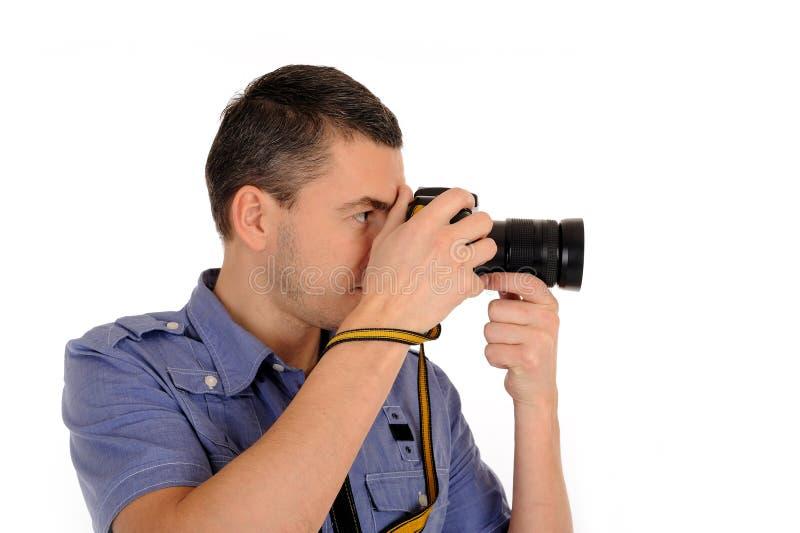 Fotógrafo de sexo masculino profesional que toma el cuadro imagen de archivo