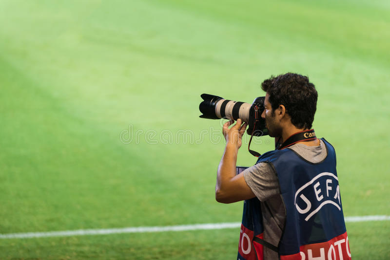 Fotógrafo do futebol fotos de stock royalty free