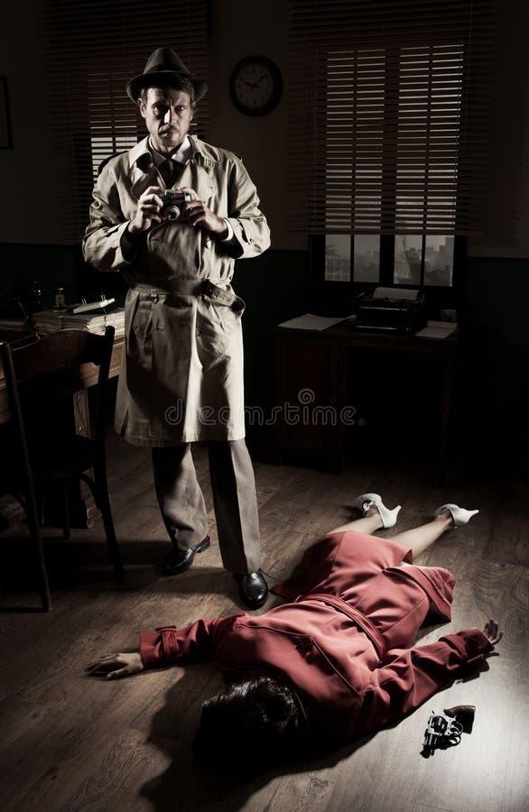 Fotógrafo en escena del crimen foto de archivo