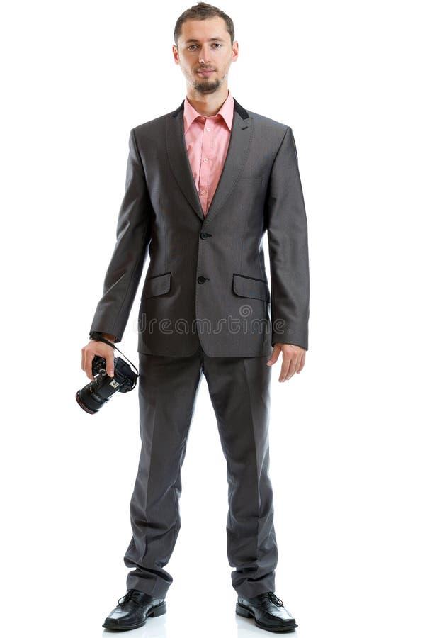 Fotógrafo integral del lazo del traje con la cámara fotografía de archivo