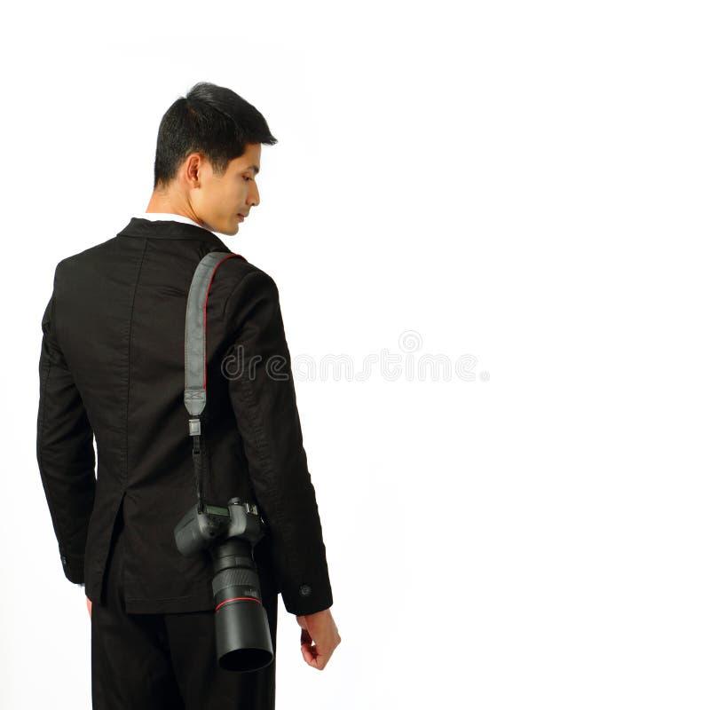 Fotógrafo joven con una cámara imagenes de archivo