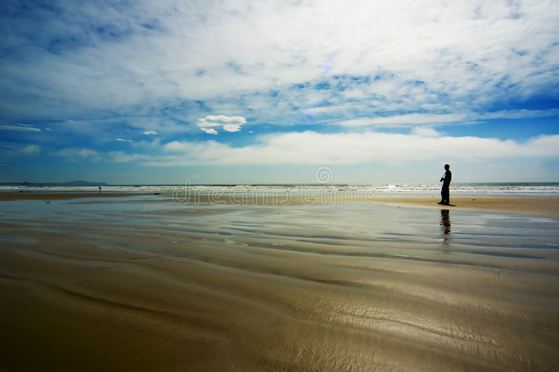Fotógrafo na praia foto de stock