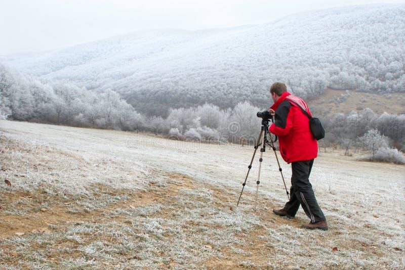 Fotógrafo no inverno fotografia de stock