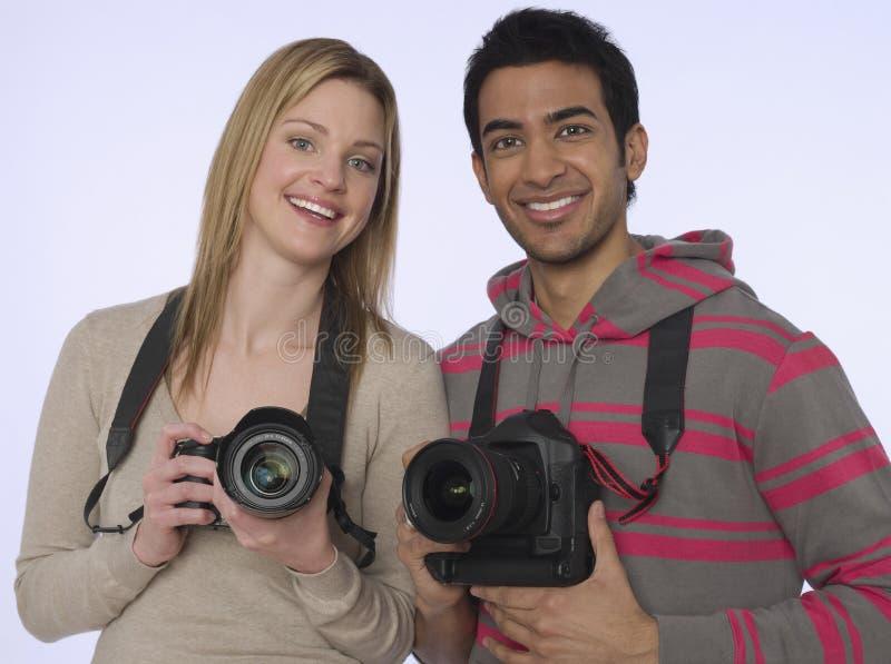 Fotógrafo novos com câmeras foto de stock royalty free