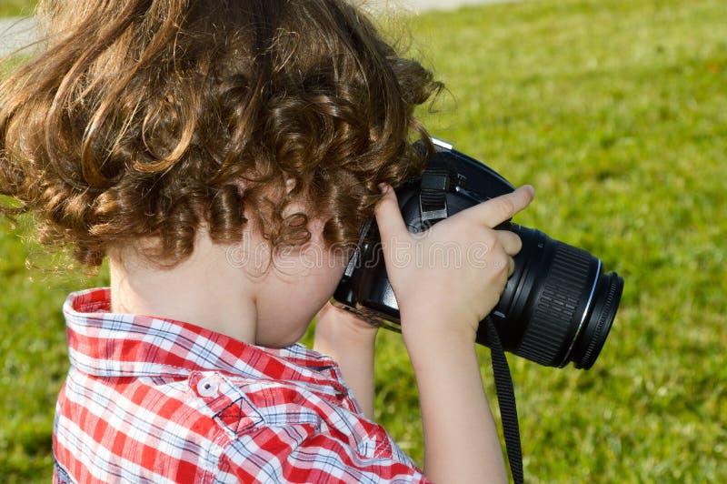 Fotógrafo pequeno da criança imagens de stock royalty free