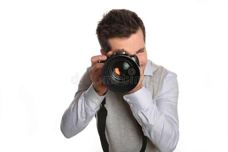 Fotógrafo que guardara a câmera grande foto de stock royalty free