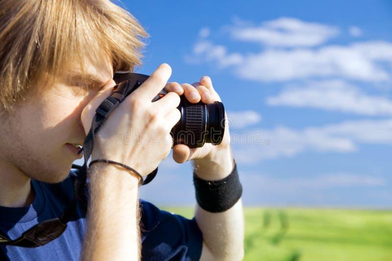 Fotógrafo que toma retratos imagens de stock royalty free
