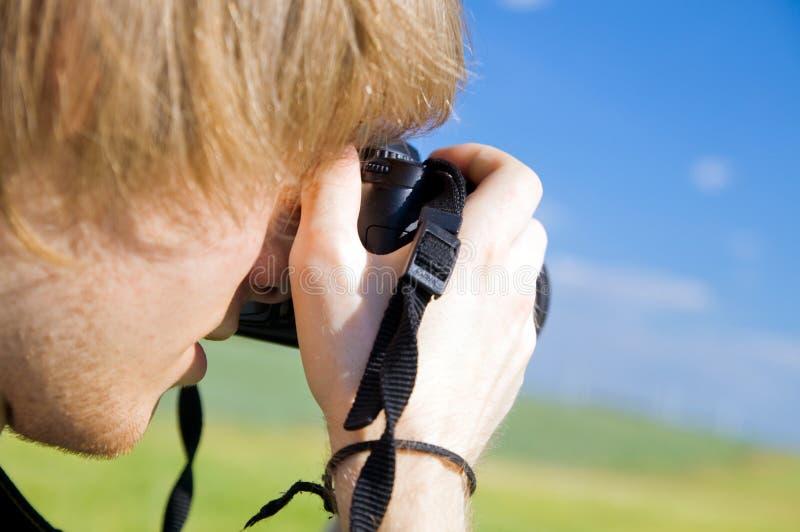Fotógrafo que toma retratos imagens de stock