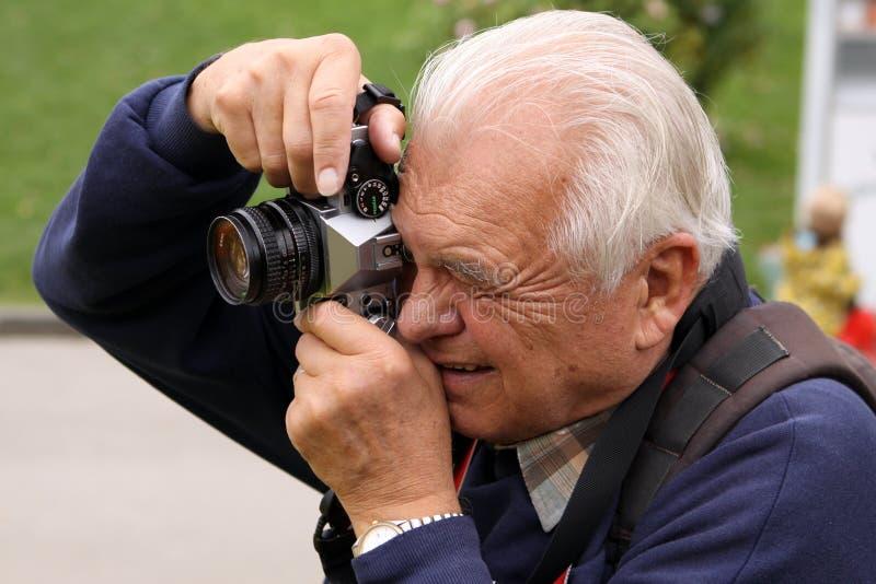 Fotógrafo sênior fotos de stock royalty free