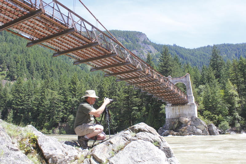 Fotógrafo y el puente de Alexandra fotografía de archivo libre de regalías