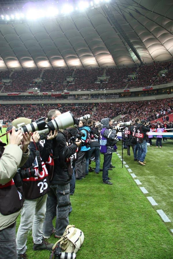 Fotógrafos de los deportes profesionales foto de archivo