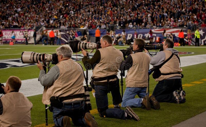 Fotógrafos en el campo fotografía de archivo libre de regalías
