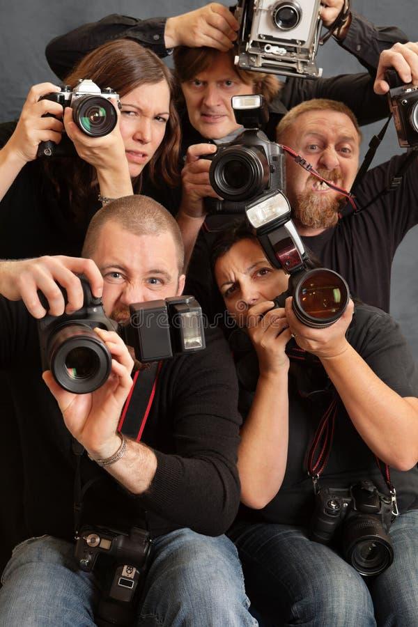 Fotógrafos locos imagen de archivo libre de regalías