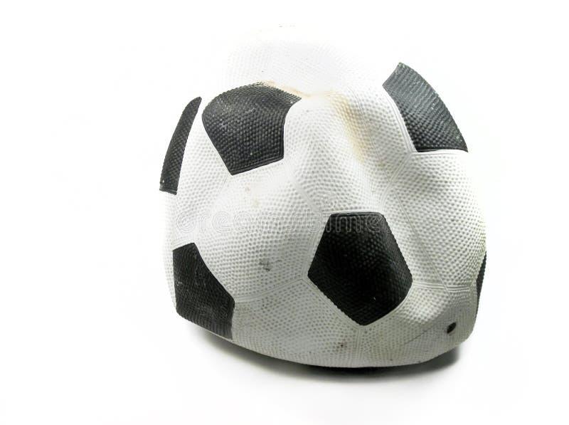 Fotboll klumpa ihop sig fotografering för bildbyråer