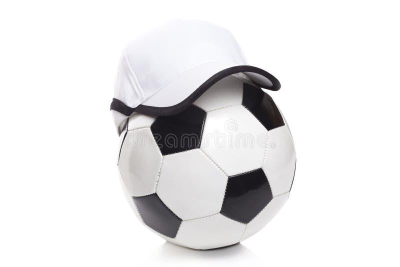 Fotbollboll med ett lock fotografering för bildbyråer