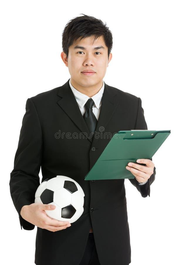 Fotbollchef med fotbollbollen och tactcial bräde royaltyfria foton