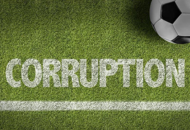 Fotbollfält med texten: Korruption arkivbilder