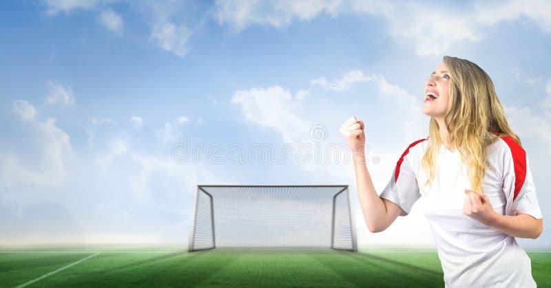 Fotbollfan som firar med näven och mål på graden royaltyfria foton