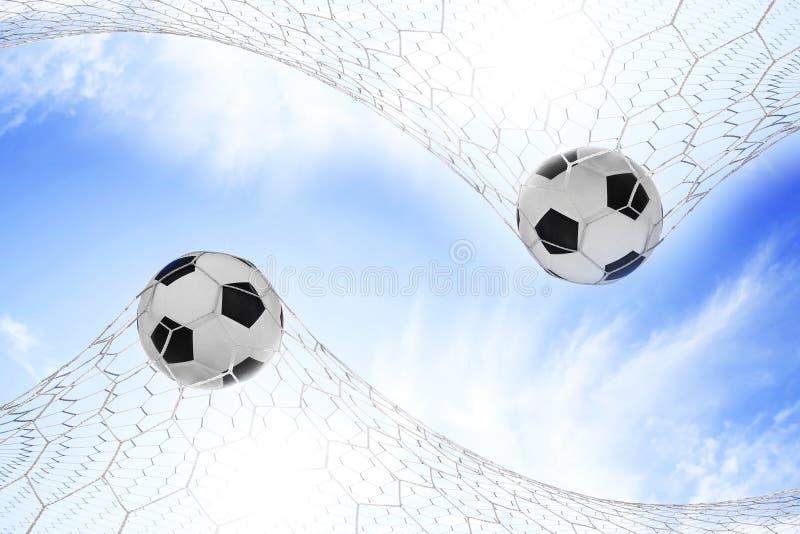 Fotbollfotboll i mål royaltyfri bild