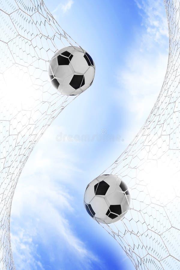 Fotbollfotboll i mål förtjänar royaltyfri bild