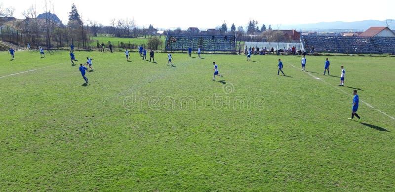 Fotbolllek i progres arkivfoton