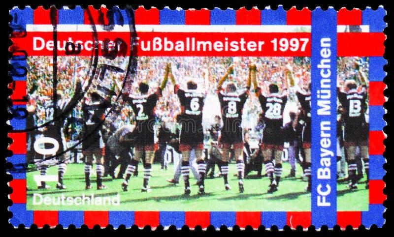 Fotbollmästare - fotbollklubba Bayern Munchen, serie, circa 1997 arkivfoton