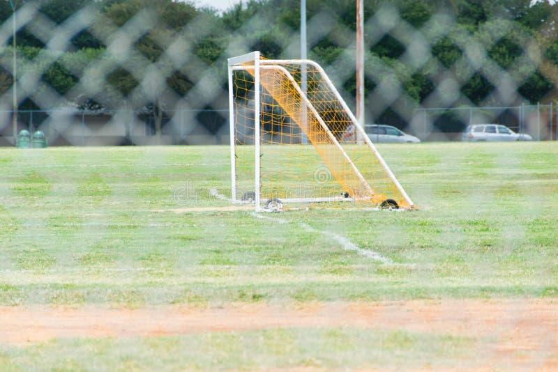 Fotbollmål på idrotts- fält royaltyfria foton
