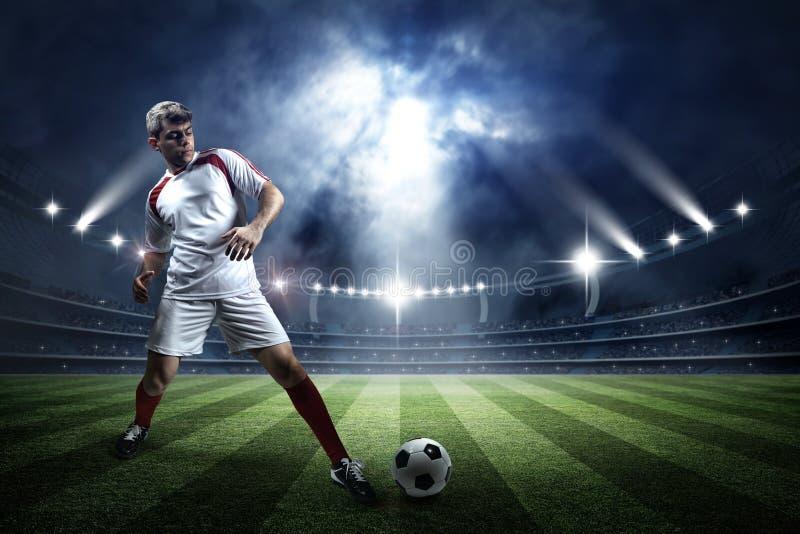 Fotbollsarena och spelare royaltyfri foto