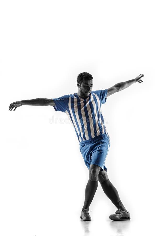 Fotbollspelare för yrkesmässig fotboll i handling som isoleras på vit bakgrund royaltyfri foto