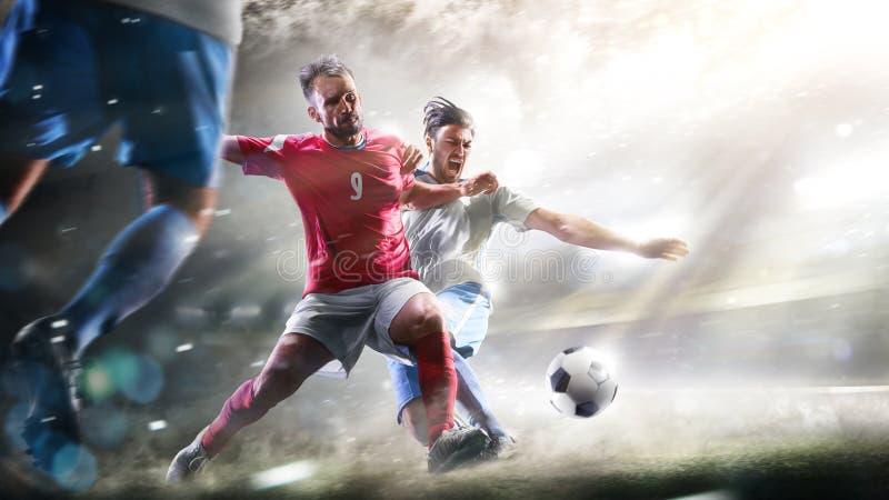 Fotbollspelare i handling på den storslagna stadionbakgrundspanoraman royaltyfria bilder