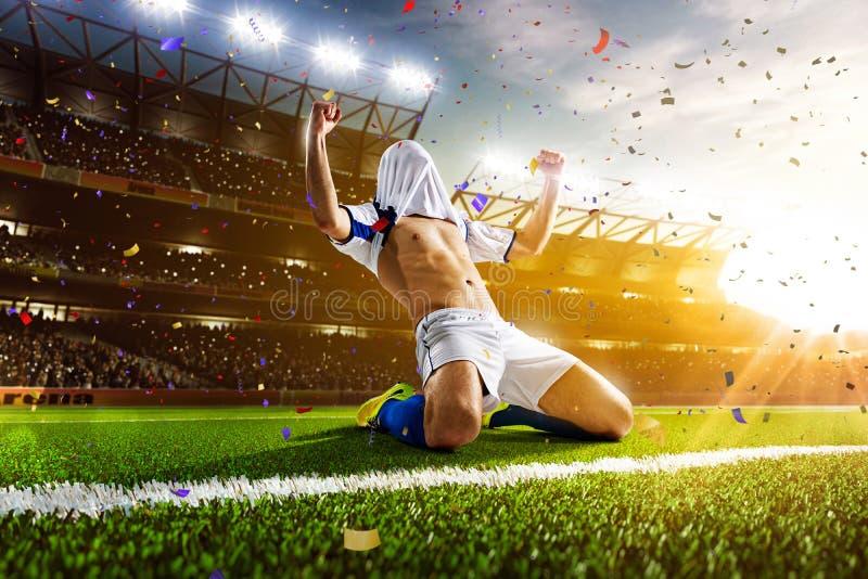 Fotbollspelare i handlingpanorama royaltyfri foto