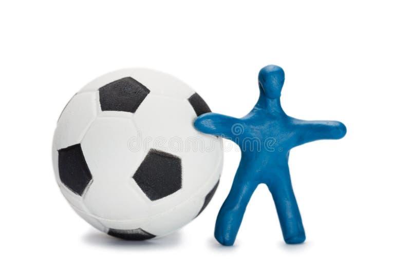 Fotbollsspelare för små plastiska personer royaltyfria foton
