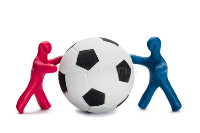 Fotbollsspelare för smågrisar royaltyfri foto