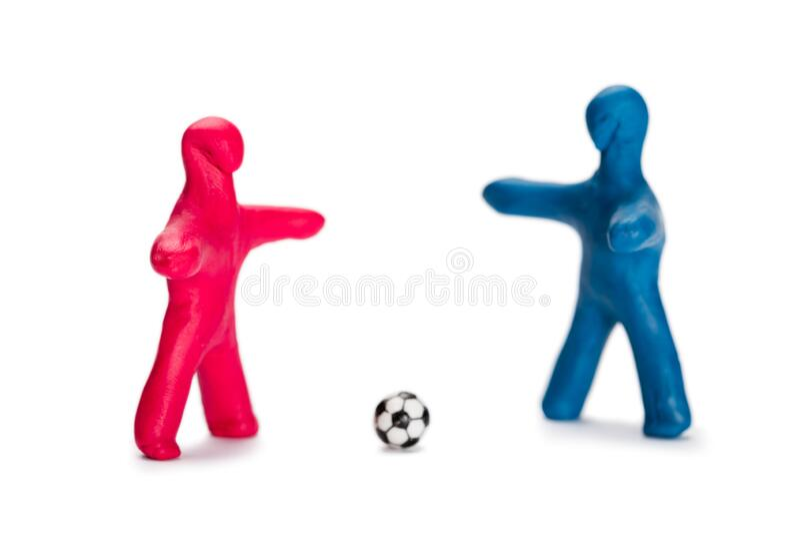 Fotbollsspelare för smågrisar arkivfoto