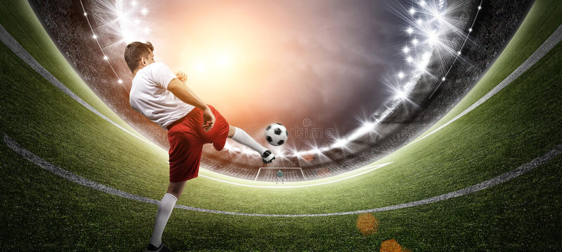 Fotbollsspelare i stadion arkivfoto