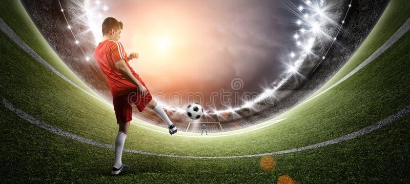 Fotbollsspelare i stadion arkivbilder