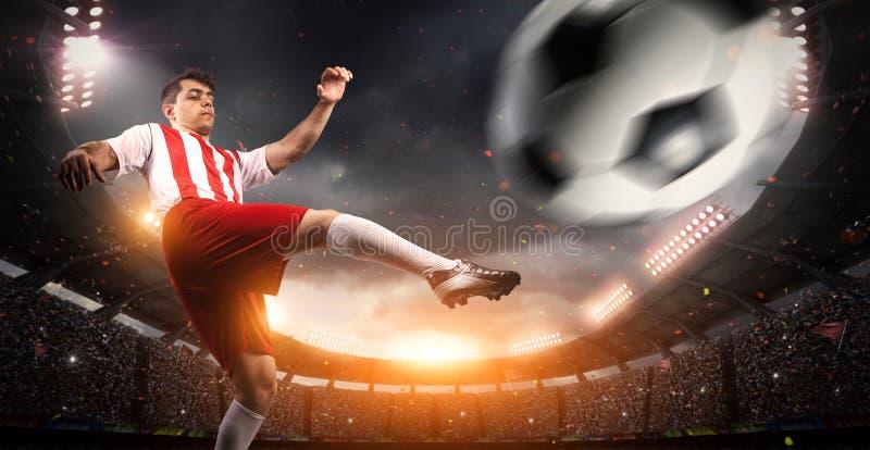 Fotbollsspelare i stadion arkivbild